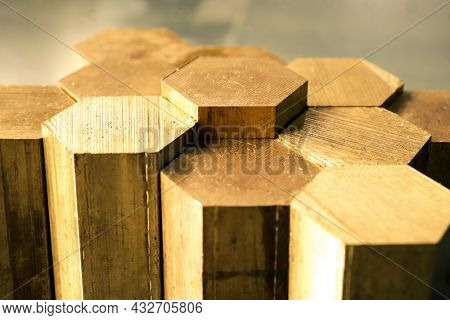 Hexagon Made Of Brass Sawn Into Blanks For Further Processing On A Metalworking Machine. Metal Cutti