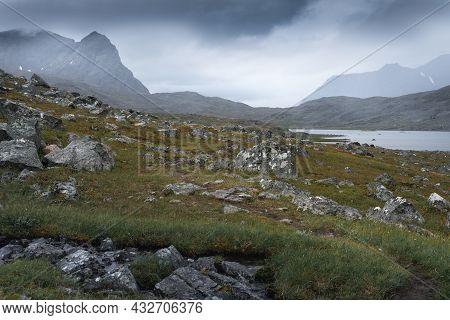 Mountain Lake And Surrounding Peaks In Sarek National Park In Bad Weather Of Arctic Summer. Snavvaja