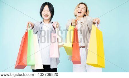 Shopaholic Female Friends. Hot Sale. Black Friday. Enjoying Life. Stylish Happy Asian Caucasian Wome