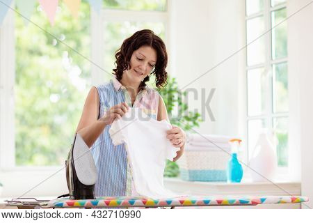 Woman Ironing Clothes. Home Chores.