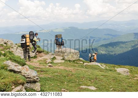 Ukraine 08 July, 2021 - Active Hikers Hiking With Heavy Backpack In Mountains. Tourism Or Freedom Co