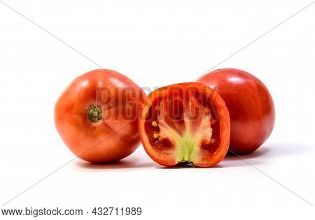 Isolated Tomato. Two Whole Tomatos And And Slice Of Fresh Tomato Isolated On White Background With C