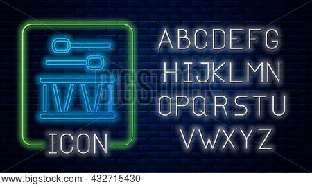 Glowing Neon Drum With Drum Sticks Icon Isolated On Brick Wall Background. Music Sign. Musical Instr