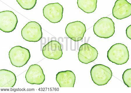 Sliced Cucumber Cross-sections Isolated On White Background. Abstract Food Pattern.