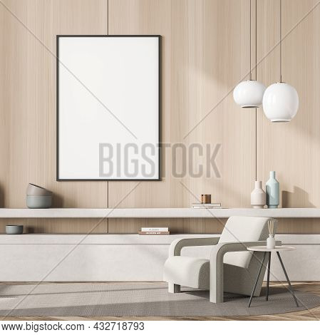 Empty White Canvas On The Wooden Wall Of The Seating Area With A Beige Armchair, Two Pendant Lamps A