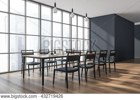 Dining Room Interior With A Panoramic View, Three Pendant Lights, A Table With Eight Chairs, A Wood