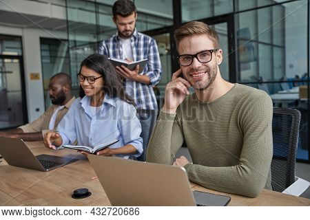 Workers Speaking Together In Cozy Conference Room