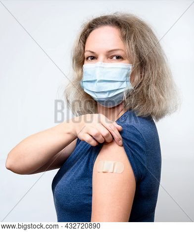 Vaccinated Young Woman Showing Shoulder With Plaster, Pretty Person In Mask After Getting Covid-19 V
