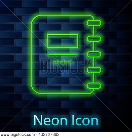 Glowing Neon Line Notebook Icon Isolated On Brick Wall Background. Spiral Notepad Icon. School Noteb
