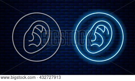 Glowing Neon Line Ear Listen Sound Signal Icon Isolated On Brick Wall Background. Ear Hearing. Vecto