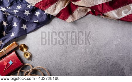 Happy Columbus Day Concept. Vintage American Flag, Compass, Paper Boat, Rope On Dark Stone Backgroun