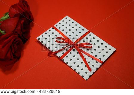 3 Red Roses With  Gift Envelope, Red Ribbon, Certificate, Invitation Inside. Craft Concept. Red On T