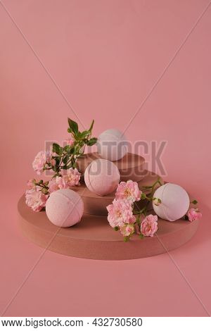 Bath Bombs With Rose Extract.pink Bath Bombs And Pink Rose Flowers On Burgundy Pedestal On A Pink Ba