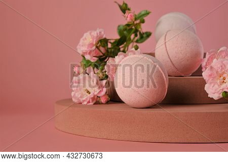 Bath Bombs With Rose .pink Bath Bombs And Pink Rose Flowers On Burgundy Pedestal On A Pink Backgroun