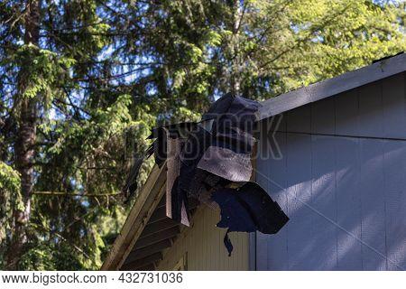 Scraped Off Roof Shingles Dangling Off Roof Edge