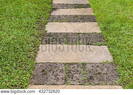Laterite Stone Walkway Inside The Green Lawn