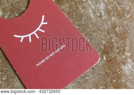 Do Not Disturb Paper Signs Are Placed On Wooden Tables Inside The Hotel