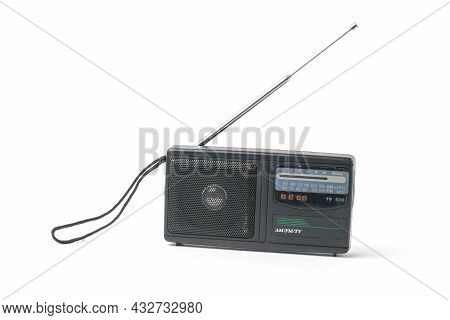 An Antique Radio Receiver With An Extended Antenna Isolated On A White Background. Vintage Radio Equ