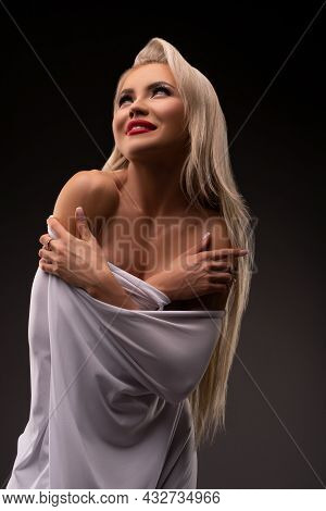 Dreamy Attractive Woman Covering Body With White Cloth