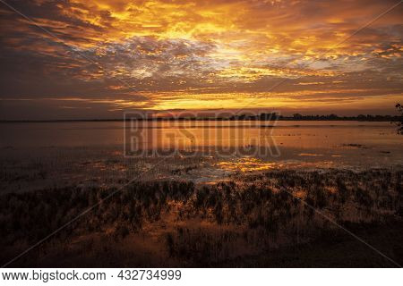 Scenic View Dramatic Beautiful Sunset Sky. Natural Sunset Sunrise On Meadow Silhouette Shadow Dark L