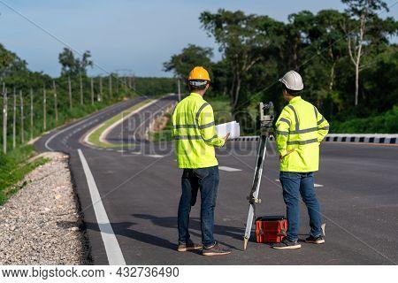 Asian Surveyor Engineers Worker Making Measuring With Theodolite Instrument Equipment During Constru