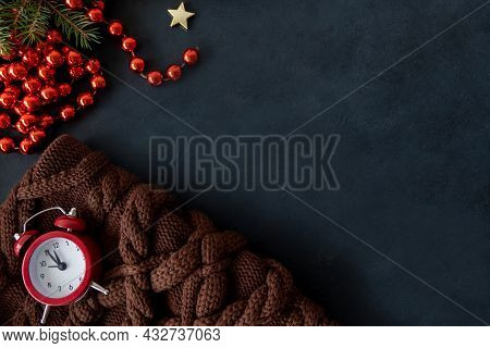 Christmas Eve. Celebration Time. New Year 2022 Party Night. Red Alarm Clock On Cozy Warm Knitted Bla