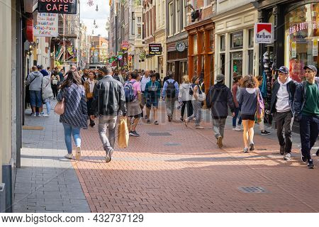 Amsterdam-netherlands - August 21 2017; People Walking In Typically European Street Street Lined Wit