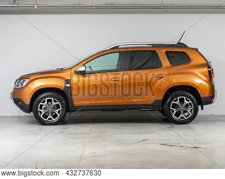Novosibirsk, Russia - August 19, 2021:  Orange Renault Duster, Side View. Popular Car On A Parking