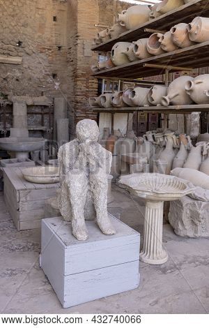 Pompeii, Naples, Italy - June 26, 2021: Plaster Cast Of Human Body Of Victim The Eruption Of The Vol