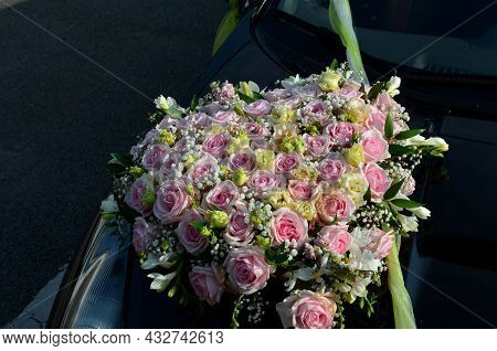 Wedding Decoration Of A Black Sports Limousine Where The Flower Is Attached With A Suction Cup To Th