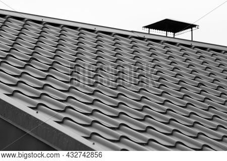Black Metal Shingles Roof Slope, Background Photo With Selective Focus