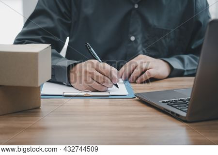 Postal Man Check Order List For Transport Parcels And Use Laptop Check Stock Order Online Order And