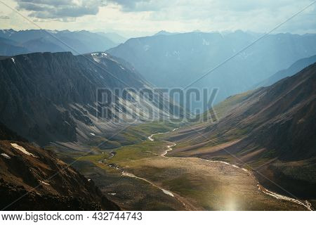 Scenic Mountain Landscape Of Motley Mountain Valley With River In Golden Sunlight. Wonderful Sunny H