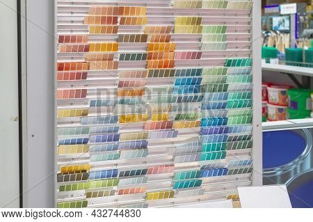 Palette With Shades Of Colors For Tinting Paint On The Counter In The Store.