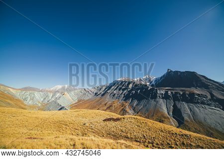 Awesome Autumn Landscape With Great Snow-covered Mountains And Sharp Rockies. Spectacular Colorful V
