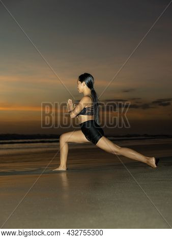 Beach Yoga. Ashta Chandrasana. High Lunge Pose Lengthens The Sides Of The Body, Opens Hips. Hands In