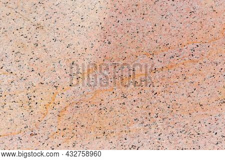 Flat Side Of The Block Of Pink Yellow Granite After Working Of The Stone Cutting Tool Close-up, Text