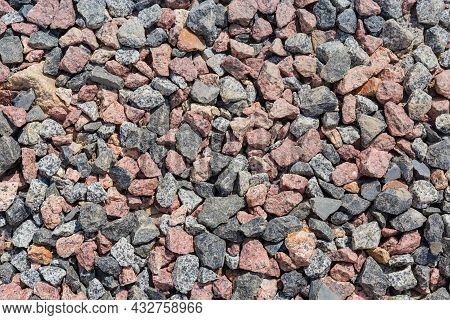 Section Of The Ground Covered With Gray And Red Granite Rubble Outdoors, Top View Close-up
