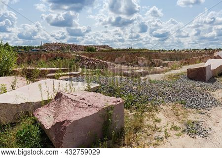 Large Blocks Of Red Granite With Flat Sides After Stone Cutting Tool Work And Torn Edges Against The