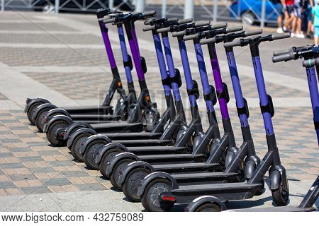 Electric Scooters For Rent Standing On The Street In The City Center