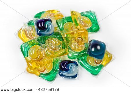Heap Of Colored Different Laundry Detergent Capsules On A White Background