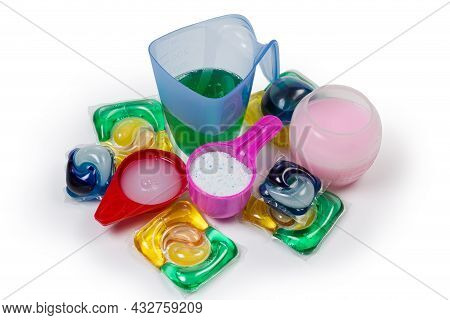 Various Laundry Detergents In Form Of Powder, Liquid, Gel In Measuring Cups And Scoop, Different Lau
