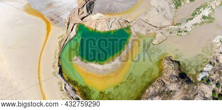 Colored Lake Among The Old Waste Rock Dumps Arisen On The Site Of The Abandoned Ilmenite Quarry Agai