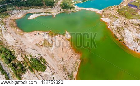 Colored Lakes Among The Old Waste Rock Dumps Arisen On The Site Of The Abandoned Ilmenite Quarry, Ae
