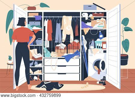 Woman In Front Of Messy Untidy Wardrobe. Mess And Chaos In Open Closet. Person Looking Inside Cupboa