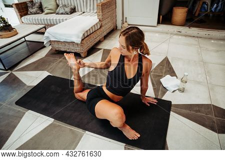 Caucasian Female Yogi Stretching Outside On The Porch
