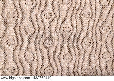 Beige Texture Of Knitted Wool Sweater. Hand Knitting. Elongated Stitch Pattern.