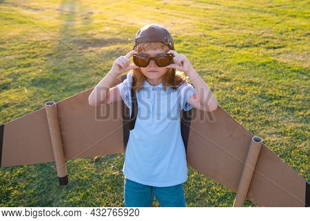 Child Boy Playing With Toy Airplane Wings. Dream Of Becoming A Pilot. Superhero Flying.