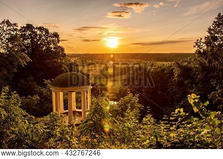 Old Pavilion In A Picturesque Location With Green Trees And Sun Shining. Sednev.ukraine