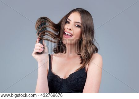 Brushing Hair. Portrait Young Woman Brushing Straight Natural Hair With Comb. Girl Combing Long Heal